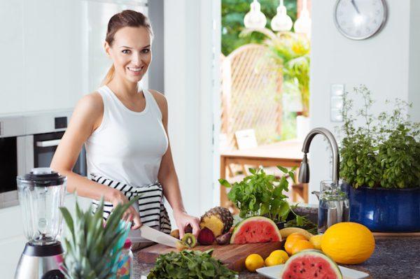 Woman preparing healthy fruit salad