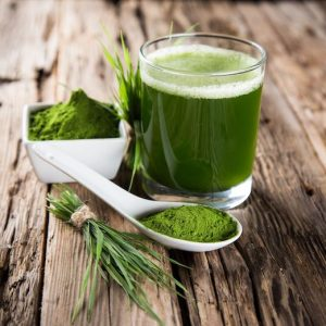 Glass full of green juice for detox program