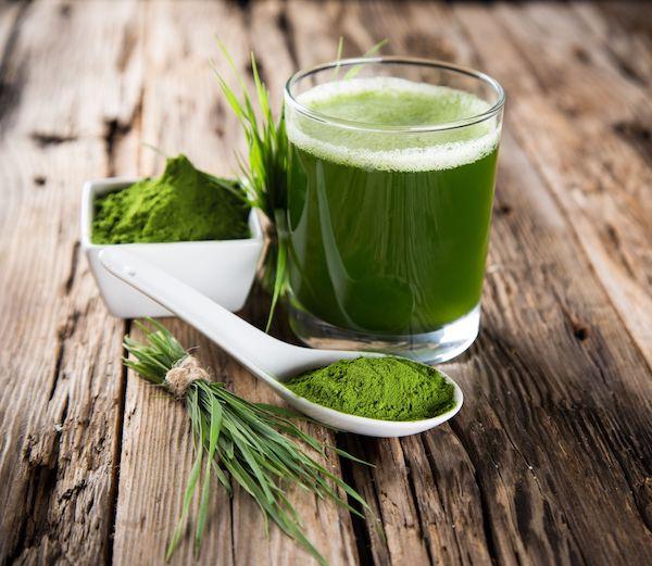 Glass full of green juice for detox program
